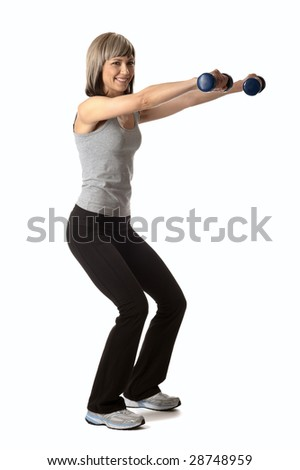 Young beautiful sportswoman exercising with dumbbells