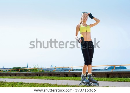 Young, beautiful, sporty and fit girl on skates - stock photo