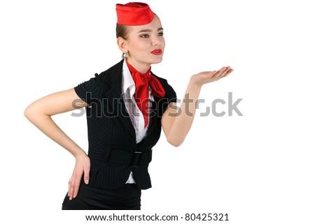 young beautiful stewardess blowing  a kiss - stock photo