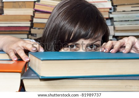Young beautiful student girl behind books - stock photo
