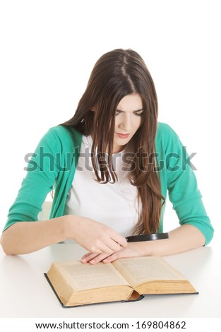 Young beautiful student sitting with book, reading, learning. Isolated on white.