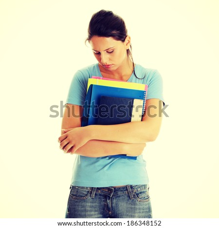 Young beautiful student woman with depression isolated on white - stock photo