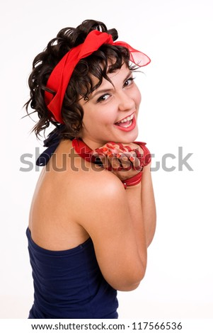 Young beautiful stylish retro brunette girl with surprised expression with manicured hand - stock photo