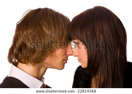 Young beautiful teenage couple sharing a secret - stock photo