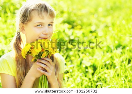 young beautiful teenager girl with dandelion bouquet - stock photo