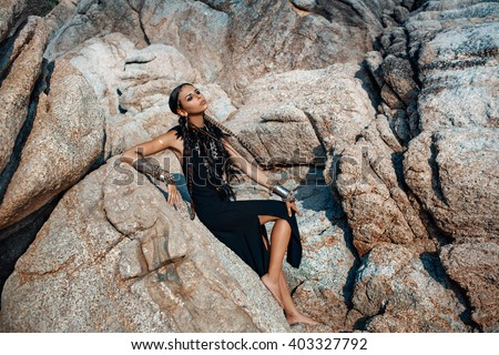 young beautiful tribal girl on the rocks