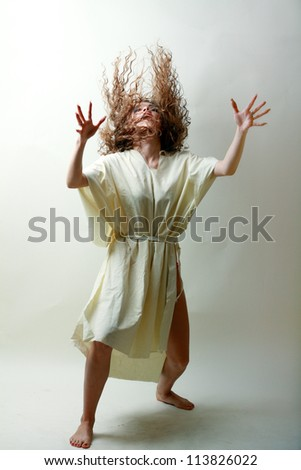 Young beautiful witch cast a spell curse - stock photo