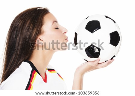 young beautiful woman about to kiss a football on white background - stock photo