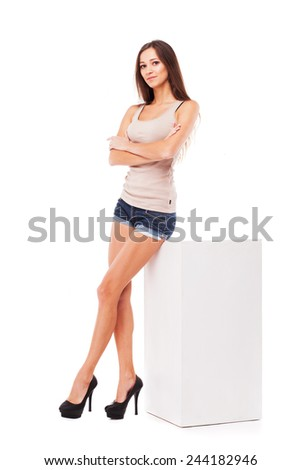 Young beautiful woman against white background  - stock photo