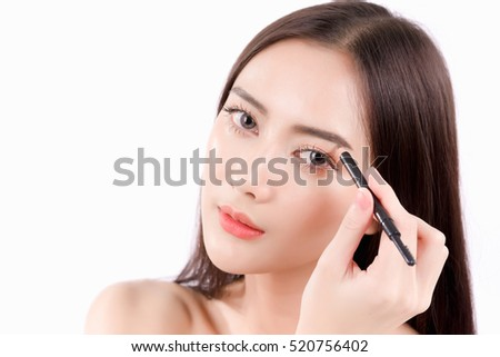 Young beautiful woman applying cosmetic powder brush on eyebrow, natural makeup, beauty face, isolated over white background.