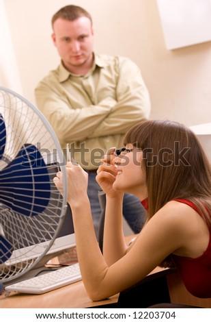 young beautiful woman applying make-up at office - stock photo