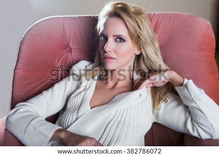 Young beautiful woman at home