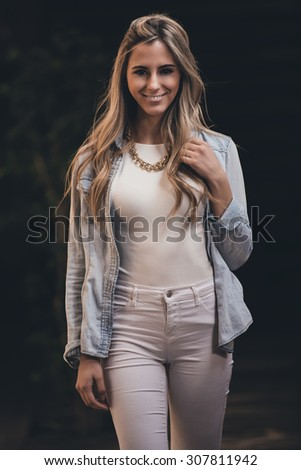 Young beautiful woman at the city. - stock photo