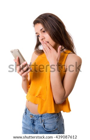 Young beautiful woman at the phone, isolated over a white background - stock photo