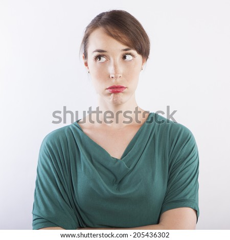 young beautiful woman bored face expression - stock photo