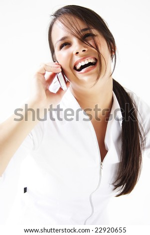 Young beautiful woman bursting out laughing on cellphone. - stock photo