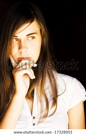 Young beautiful woman concerned about something - stock photo
