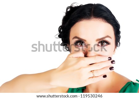 Young beautiful woman covering her mouth with her hand - stock photo
