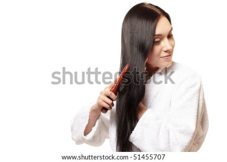 young beautiful woman do her long straight healthy hair - stock photo