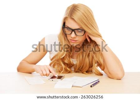 Young beautiful woman doing her accounts. - stock photo