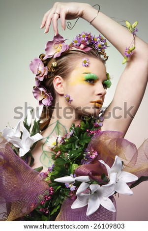 Young beautiful woman dressed as Spring. - stock photo