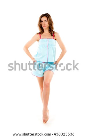 Young beautiful woman dressed in blue pajamas isolated on a white background