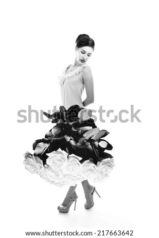 Young beautiful woman dressed in elegant dress of fresh rose flowers, black and white - stock photo