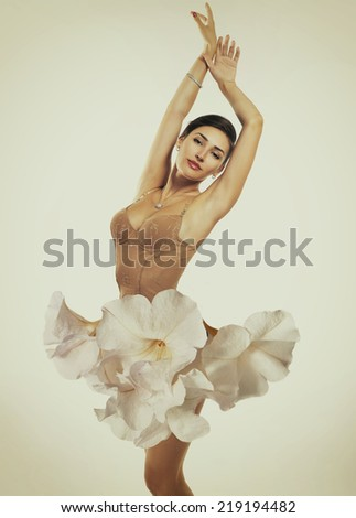 Young beautiful woman dressed in elegant dress of fresh white flowers, image toned - stock photo