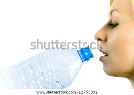 Young beautiful woman drinking mineral water isolated on white.