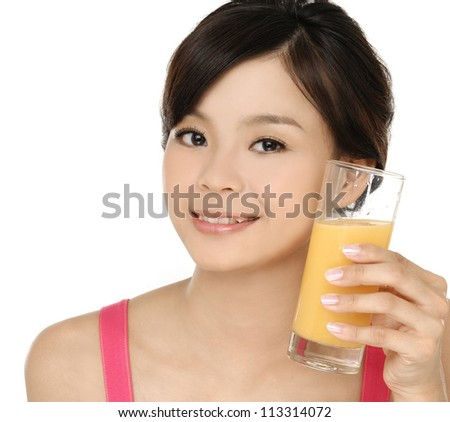 Young beautiful woman drinking orange juice isolated - stock photo