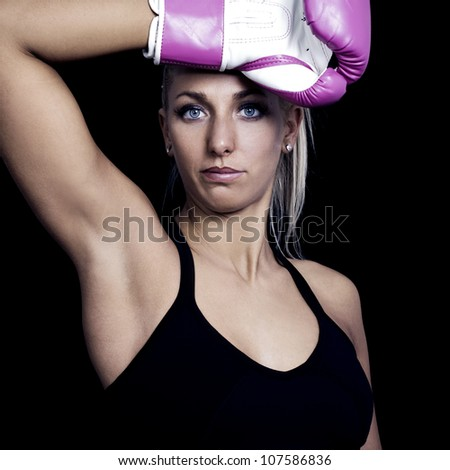 young beautiful woman during fitness and boxing - colorized photo - stock photo