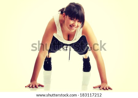 Young beautiful woman during fitness time and exercising, isolated on white background  - stock photo