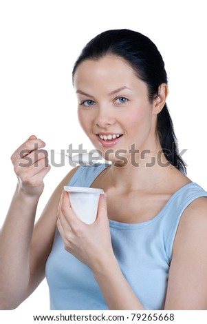 Young beautiful woman eating yogurt as breakfast or snack. Isolated on white background - stock photo