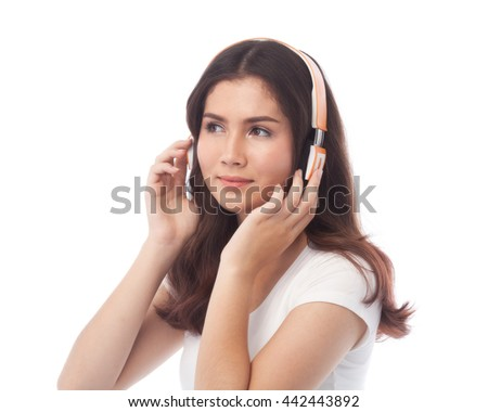 Young beautiful woman enjoy music with bluetooth wireless headphone. Isolated white background, white t-shirt. - stock photo