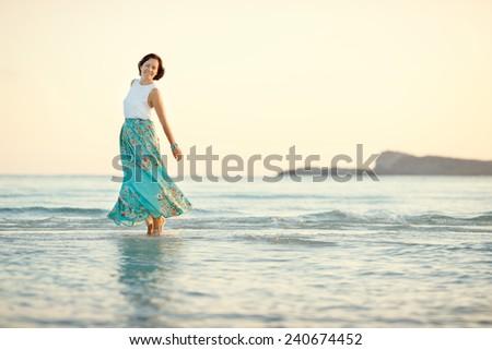 Young beautiful woman enjoying beach vacation, Sardegna, Italy - stock photo