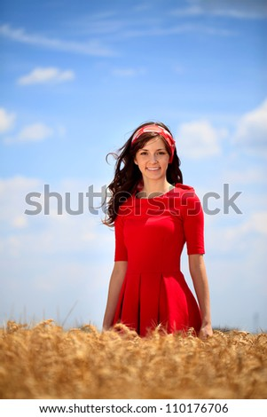 Young beautiful woman enjoying in nature