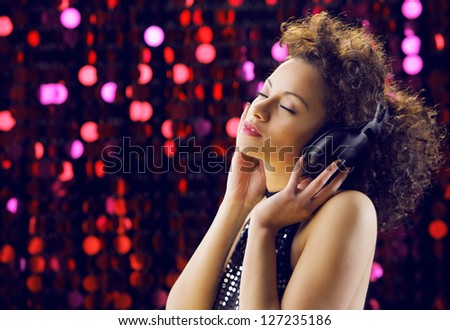 young beautiful woman enjoying music - stock photo