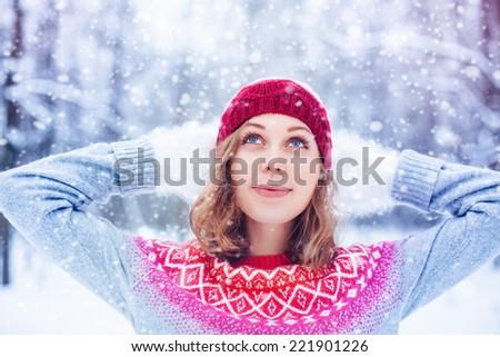 Young beautiful woman enjoying snowing - stock photo