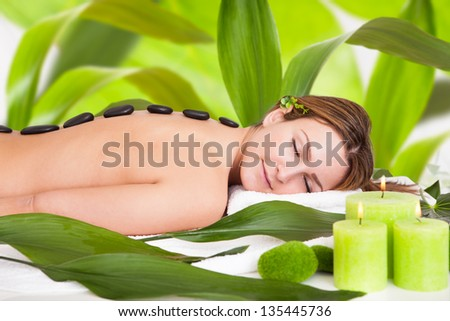 Young Beautiful Woman Enjoying Spa Stone Therapy