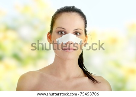 Young beautiful woman face after nose surgery - stock photo