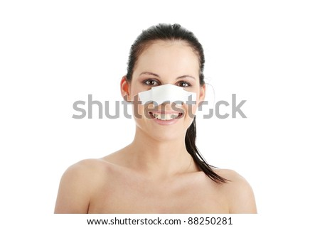 Young beautiful woman face after nose surgery