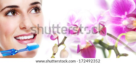 Young beautiful woman face with flowers collage. - stock photo