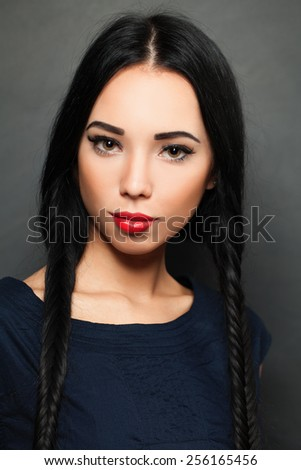 Young beautiful woman fashion model with fashionable hairstyle and make-up - stock photo