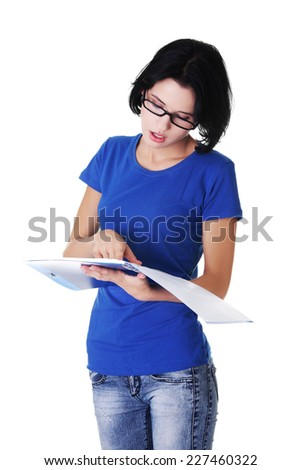 Young beautiful woman holding notes - stock photo