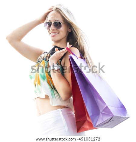 Young beautiful woman holding shopping bags. Isolated white background. - stock photo
