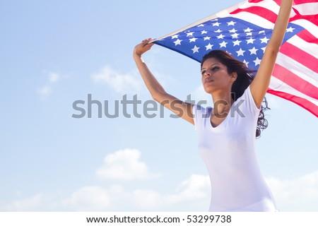 young beautiful woman holding USA flag - stock photo