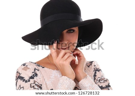 Young beautiful woman in a hat isolated over white background