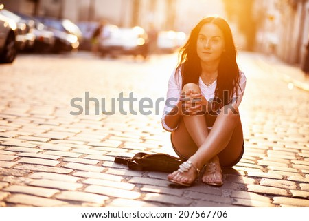 Young beautiful woman in an old city street - stock photo
