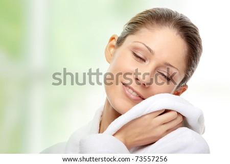 Young beautiful woman in bathrobe. - stock photo