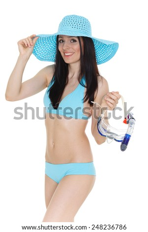 Young beautiful woman in bikini holds mask for diving standing on a white background. Vacation. - stock photo